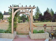 Railroad ties instead of stone for the side gardens.  Perfect for the area of the old driveway