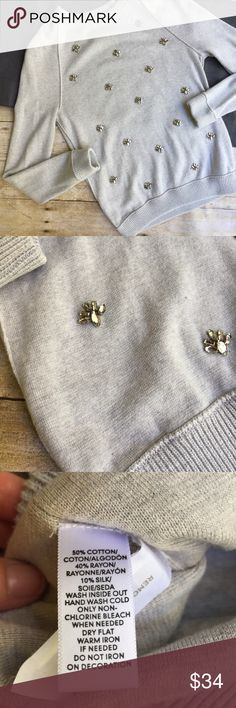 """Loft Jeweled Grey Sweater Grey sweater with ribbed cuffs and collar • beautiful jeweled embellishments on Front • cotton/Rayon/Silk Blend • 17"""" bust • 25"""" length • wonderful condition! LOFT Sweaters Crew & Scoop Necks"""