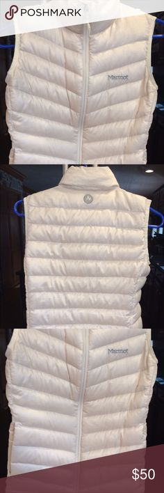 MARMOT puff vest White. Down feather puff vest. Zips from bottom to top. Two zipper pockets on front of vest. Amazing condition. Size XS. Marmot Jackets & Coats Vests