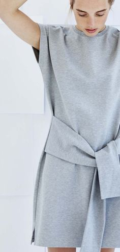 This tie front dress is crafted from a luxe sweat fabric.