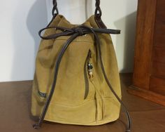 Tan Suede Leather Drawstring Bucket Bag Spicy Tan Cardamom Shoulder Crossbody Handmade In USA by ForgedLeatherBags on Etsy