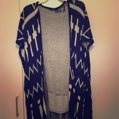 Black and white poncho black and white poncho with a funky pattern. Large arm holes fastened with cute buttons. Looks great with leggings for a casual look., or with jeans and heels for a fun weekend outfit! Lightly worn. From Forever 21. Sweaters Shrugs & Ponchos