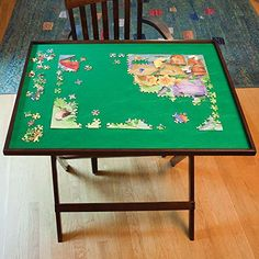 Bits and Pieces - Foldaway Jigsaw Puzzle Table - Set up Puzzle Fun Anywhere - Folds Flat for Easy Storage When Not in Use - Jigsaw Puzzle Accessories Bits and Pieces http://www.amazon.com/dp/B00O7WRLHW/ref=cm_sw_r_pi_dp_uQwaxb0GA23BC
