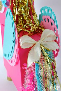 This Unicorn Valentine Card Box DIY project is a fun whimsical twist on a…
