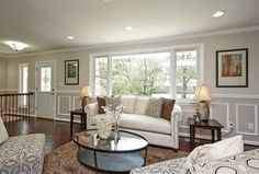 Energy Efficient Home Upgrades in Los Angeles For $0 Down -- Home Improvement Hub -- Via - Transitional Living Room with Chair rail, Milgard Style Line Series Picture Window, High ceiling, Camilia Ivory Area Rug