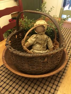 My home. Old baskets, bowl and old cloth primitive doll.
