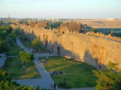 """""""The fortified city of Diyarbakir, Turkey & the landscape around has been an important centre from the Hellenistic period, Roman,Sassanid,Byzantine, Islamic, & Ottoman times to the present. The site encompasses the Amida Mound, known as İçkale (inner castle), the 5.8km-long city walls with numerous towers, gates, buttresses, & 63 inscriptions from different periods, as well as Hevsel Gardens, a green link between the city & the Tigris that supplied the city with food and water."""""""