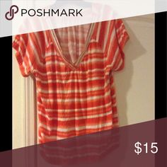 Weekend Go To If you love orange like I do then this one is for you. Orange and white stripe w/silver neckline. Elastic at the arms and waist. Only worn twice. Perfect for summertime with a pair of shorts. Lane Bryant Tops Tees - Short Sleeve