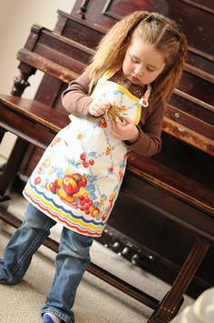 Darling apron made from vintage linens....love this, mom always had an apron for me that was just like hers ♥