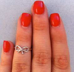 Silver Bow Knuckle Ring $12.99, via Etsy. I NEED this!!!!!