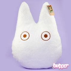 This cute pillow is a must-have for all Totoro fans! This pillow is a fantastic reproduction of Chibi Totoro (the small white one). It's made from lovely soft imitation fur and stuffed with a soft cushion. Chibi Totoro is eagerly waiting to be taken to your home so you can cuddle him.