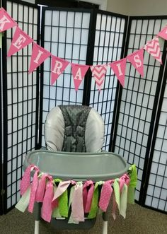 Pink and Lime green.  Decorated highchair with banner and screen background.