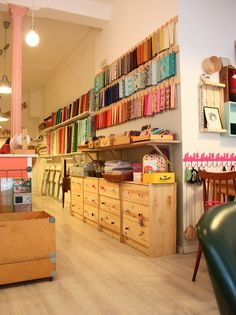 Craft/ sewing room  --  looks more like a store than a craft room, but at least it is neat and organized!