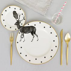 A one of a kind matching dinner and side plate set with quirky stag and owl illustration across both.