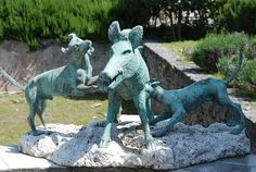 Pompeii, House of the Citharist. In the center of a rectangular garden is a bronze statue of a boar being attacked by dogs. A copy of the statue group is on display while the original can be viewed in the NAMN - AD 79 eruption