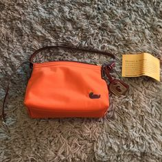 """Auth Dooney & Bourke Orange neon handbag Used this bag 1x-zip top closure with leather pull tie-leather arm strap 15"""" (full length)-leather & gold dooney & Bourke tag-interior leather dog clip strap (for keys)-1 interior zip side pocket & 3 slip in pockets-authentic with serial numbers-measures:8"""" (w) x 6"""" (h) x 4"""" (d) Dooney & Bourke Bags Shoulder Bags"""
