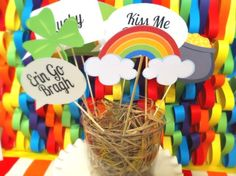 Photo props and rainbow backdrop at a St. Patrick's Day party #photoprops #rainbow