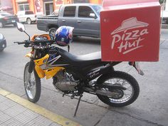 That's a legit use of a motorbike!  Pizza Hut Motorcycle in La Cebia, Honduras.