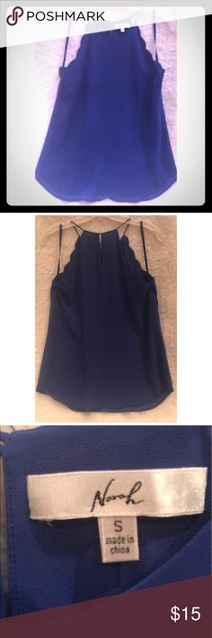 Bright Electric blue halter Tank Beautiful and Bright Electric Blue Halter top Tank. I love this cut , and how your collar bones pop out being exposed to the light on a sunny ☀️ Day 😊 Never wore, but sadly I took the Tags off. Would be great with a ladies sport coat, suit,or even white shorts for. Night on the town.Small but fits more like a Medium. Norah Tops Tank Tops