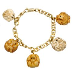 TAFFIN Mammoth Ivory and Gold Zodiac Charm Bracelet | From a unique collection of vintage charm bracelets at http://www.1stdibs.com/jewelry/bracelets/charm-bracelets/