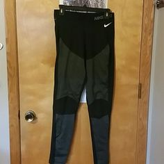 Nike shield running leggings Just bought but too big. Still has tags. Full-length never worn. The shield is on the thighs and shins. Knees are not, so you can bend and run. No trades! Womens large. FLEECE LINED!! prefect for those cold nights! Get'em now! Nike Pants Leggings
