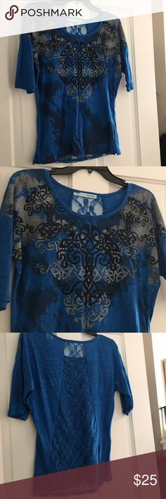 Maurice's Burnt out Top Size Small This is a really nice top! Burnt out and Lace Back all in one and a Graphic Design too! Styling and Profiling, Woo Hoo 😂. Maurice's Quality too. Don't pass this gem up! Thanks for looking at my Closet ! Maurices Tops Blouses
