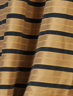 Overstock Add A Classy Look To Your Window Treatments With This - Black and gold stripe drapery fabric