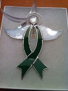Stained Glass Awareness Ribbon Angels. Each is handcrafted. To order, please visit our Facebook page: Sparkles Of Light Stained Glass and Mosaics, or contact us by email at: sparkles99@charter.net. Thanks. #StainedGlassVitrales