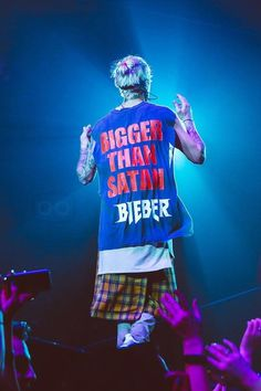Justin Bieber wearing Adidas Ultra Boost Sneakers, Fan Merchandise Custom Marilyn Manson Bigger Than Satan Band T-Shirt, Fear of God Plaid Kilt, Fear of God Essential Long Tank