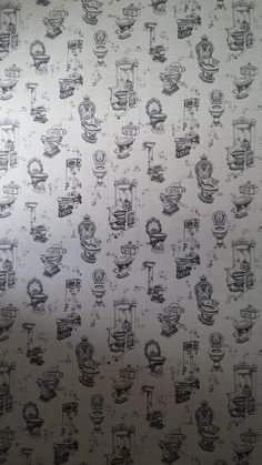 This toilet room has toilet wallpaper.