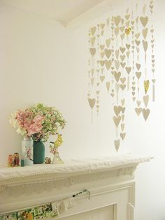 I love this little heart mobile/curtain(?) with the text paper and random little patterned pieces.