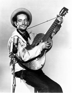 "Woody Guthrie [1912, Okemah, OK - 1967, New York City, NY] was an American singer-songwriter and musician whose musical legacy includes hundreds of political, traditional and children's songs, ballads and improvised works. One of his best-known songs is ""This Land Is Your Land."""