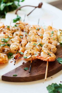 Savory, delicious Spicy Grilled Shrimp topped off with cilantro, lime, and a sweet minced tomato and pineapple sauce. This healthy recipe is perfect for a fun spring and summer weeknight dinner or having friends over! #summerrecipes