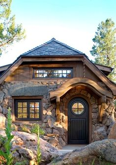 "rustic exterior by TKP Architects pc....part art studio, part home....Rocky Mountain ""Hobbit"" home"