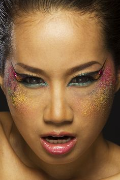 Got a little crazy creative with MAC pigments for model Karolina Von's funky eye make-up design. Photography by Daryl.