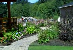 A paver pathway that introduces the huge back yard pond.
