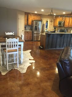 Stained concrete floors - cost-efficient, durable and beautiful! For the Rec room & downstairs bathrooms Metal Shop Building, Building A House, Building Ideas, Building Systems, Basement Flooring, Basement Remodeling, Flooring Ideas, Plywood Floors, Laminate Flooring