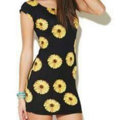 "Sunflower bodycon dress Never worn. Soft comfortable material. I'm 5'8"" and it fits me a little short, so for anyone 5'6"" and under it would be perfect. I suggest pairing it with some cute black or yellow flats. Wet Seal Dresses"