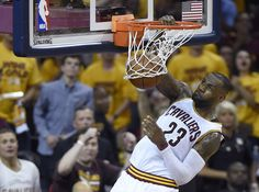 Cleveland Cavaliers forward LeBron James dunks against the Toronto Raptors during the first half of Game 5 of the NBA basketball Eastern Conference finals, Wednesday, May 25, 2016, in Cleveland. (Frank Gunn/The Canadian Press via AP)