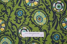 Funky retro pattern!  Has the green, blues, yellow (no red though) FabriGuru- Suzani vine cotton in Sunshine/Natural $7.95 Code 184 51.1