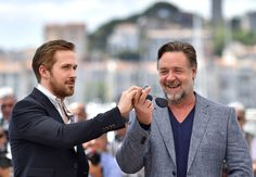 """Russell Crowe Photos - Canadian actor Ryan Gosling (L) borrows New Zealander actor Russell Crowe's sunglasses as they pose on May 15, 2016 for a photocall for the film """"The Nice Guys"""" at the 69th Cannes Film Festival in Cannes, southern France.  / AFP / LOIC VENANCE - 'The Nice Guys' Photocall - The 69th Annual Cannes Film Festival"""