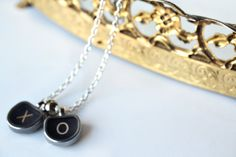 XO vintage typewriter key necklace from The hollie rogue shop.    oooh, i remember those keys.   wowzer....