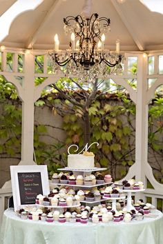 What a fabulous cupcake dessert display for a wedding! {Jason Burns}
