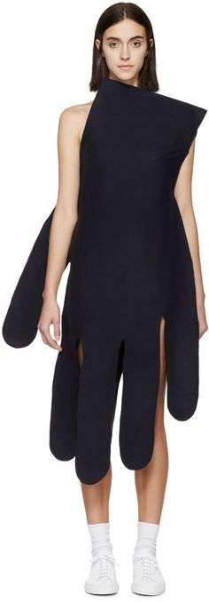 One-shoulder asymmetrical felted wool dress in navy. Hand-shaped construction. Raw edges throughout. Tonal stitching.