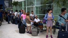 People queue for buses in Puerto Vallarta - 23 October