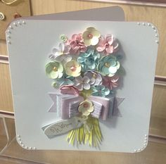 I would use a fabric ribbon tied in a simple bow From Craftwork Cards Blog