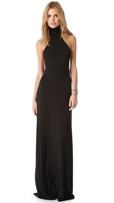 Rachel Pally Romanni Dress |  The high halter neckline of a Rachel Pally dress creates an open back, framed only by skinny straps. The lined bodice exposes the shoulders and flows uninterrupted to an unfinished hem. Unlined. #black
