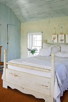 In this master bedroom, the beadboard ceiling and a series of Texas wildflowers, pressed and framed, add to the sense of place.