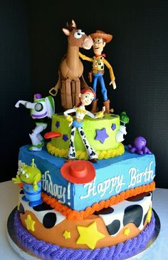 Toy Story Birthday Cake: Tiered yellow cakes filled with chocolate mousse, frosted in buttercream and topped with figurines. For a very special occasion! loves