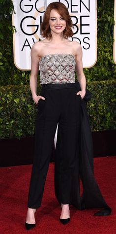 Emma Stone in Lavin, 2015  Stone arrived at the 2015 Golden Globes Awards in an impossibly cool Lanvin jumpsuit with an embellished bodice. Ofira jewels and a larger-than-life bow gave the menswear-inspired one-piece a ladylike edge. The perfect finishing touch? Stone's short and wavy bob.